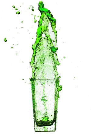 abstract liquor: Drink green splash out of glass on a white background.