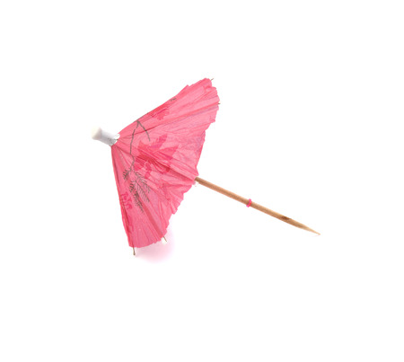 cocktail umbrella: pink cocktail umbrella isolated on white background Stock Photo