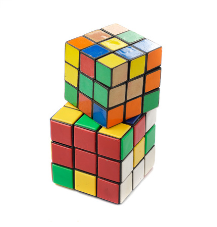 rubik: KRAGUJEVAC, SERBIA - APRIL 9, 2015: Rubiks cube on the white background. Rubiks Cube on a white background. Rubiks Cube invented by a Hungarian architect Erno Rubik in 1974.