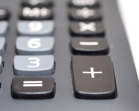 Plus button was focused on black calculator isolation on white background