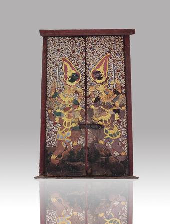 thaiart: The unique Thai art on the door of Wat Suthat on black gradient , Bangkok, Thailand