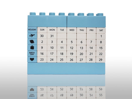 Calendar brick toy isolation on white with shadow detail by the first date of each month