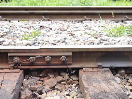 Tinted metal screw on railway track