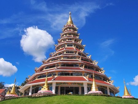 influenced: Chinese-styled pagoda in Thailand temple under blue sky