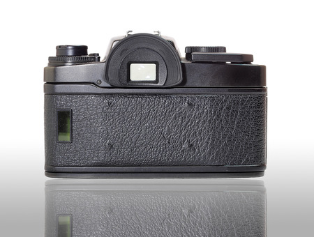 Classic film camera, rear view, isolation with reflection