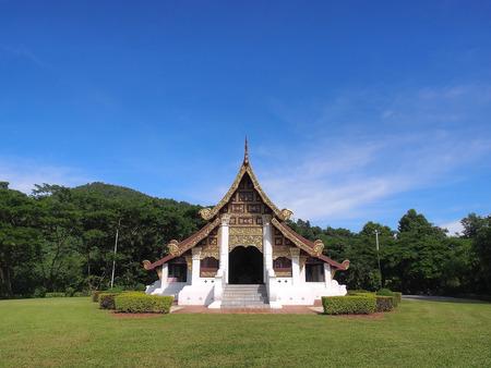 thaiart: Northern-styled Thai art in public church under blue sky, Chiangrai, Thailand Stock Photo