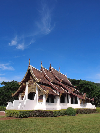 thaiart: Northern-styled Thai art in public church under blue sky, Chiangrai, Thailand Stock Photo