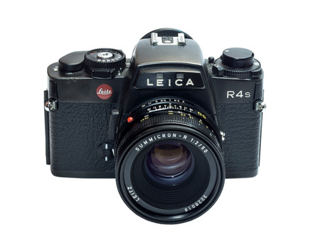Leica R4S is one of the famous SLR Leica camera, composed with normal prime lens, Summicron 50 mm, isolation on white background