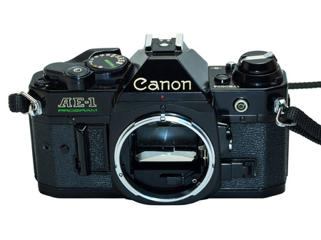 Canon AE-1 Program is the classic old-fashioned film camera, composed with normal zoom lens 35-70 mm, isolation on white background 新聞圖片