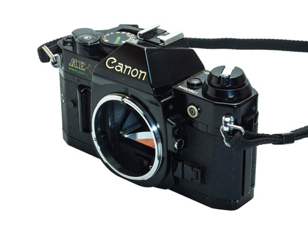 Canon AE-1 Program is the classic old-fashioned film camera, composed with normal zoom lens 35-70 mm, isolation on white background 版權商用圖片 - 31933888