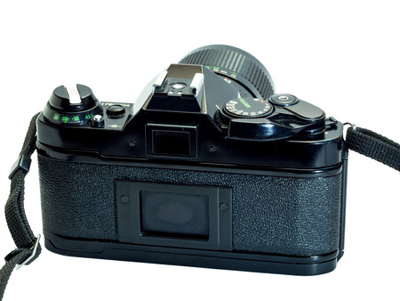Canon AE-1 Program is the classic old-fashioned film camera, composed with normal zoom lens 35-70 mm, isolation on white background 版權商用圖片 - 31933890