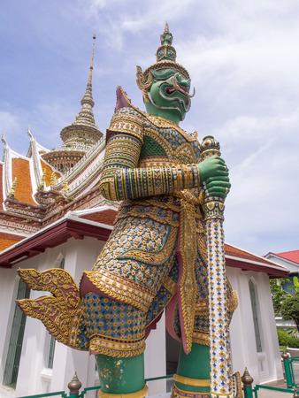 represented: Giant statue, represented gate keeper, at entrance of Dawn temple or Wat Arun, the landmark of Bangkok, Thailand Stock Photo