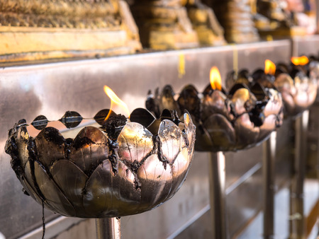 enlightment: Oil lantern in Thai temple is symbol of enlightment in Thai believe