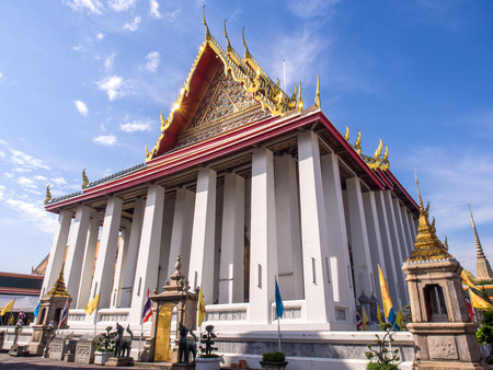 Front view of main church of Wat Pho (Temple of Reclining temple) under blue sky in Bangkok, Thailand photo
