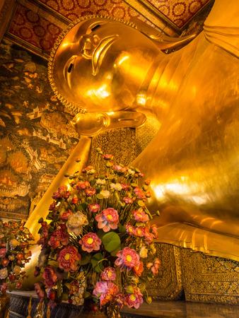 Golden reclining buddha statue in Wat Pho (Temple of Reclining Buddha) in  Bangkok, Thailand photo