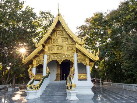 sun ray: Main church of Thai temple with evening sun ray Stock Photo