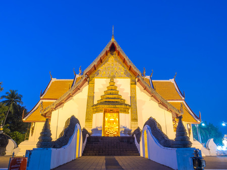 outstanding: Main church of Wat Phu Mintr is very outstanding Northern style Thai art under twilight period sky Stock Photo