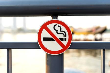 non  smoking: Non smoking sign on metal gate Stock Photo
