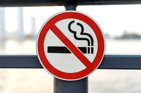non: Non smoking sign on metal gate Stock Photo