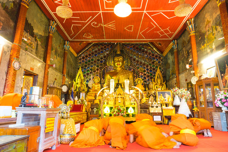 meditaion: CHIANGMAI, THAILAND - MARCH 14: Group of monks in church of Wat Phra That Doi Suthep do respect to golden meditated buddha statue in Chiangmai, Thailand, was taken on March 14, 2015.