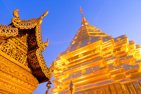 The Grand Golden Pagoda in Wat Phra That Doi Suthep is the most attractive landmark of Chiangmai in Thailand, during twilight period photo