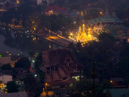 bird eye: Wat Jong Klang is landmark of Maehongson, view from bird eye view, during dark night period, presented in landscape ratio Stock Photo