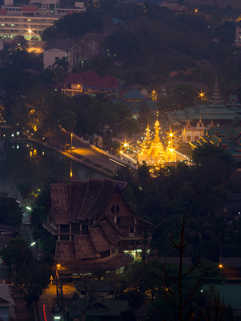 bird eye: Wat Jong Klang is landmark of Maehongson, view from bird eye view, during dark night period, presented in portrait ratio Stock Photo