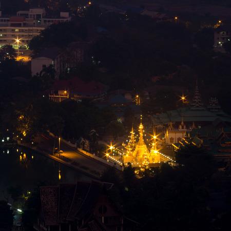 ratio: Wat Jong Klang is landmark of Maehongson, view from bird eye view, during dark night period, presented in square ratio Stock Photo