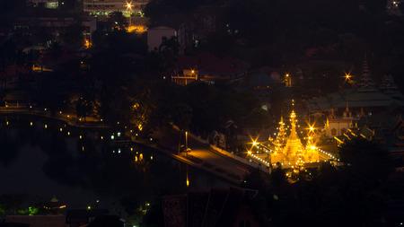 bird eye: Wat Jong Klang is landmark of Maehongson, view from bird eye view, during dark night period, presented in panoramic ratio Stock Photo