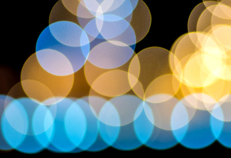 Multiple color of out of focus lens bokeh on black background photo