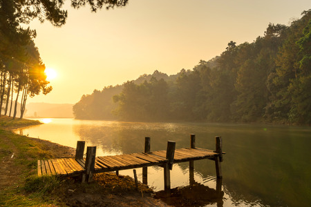 pang: Pang Oung is pretty and serene lake in a valley glittering with sunlight in morning sunrise surrounded by mountains