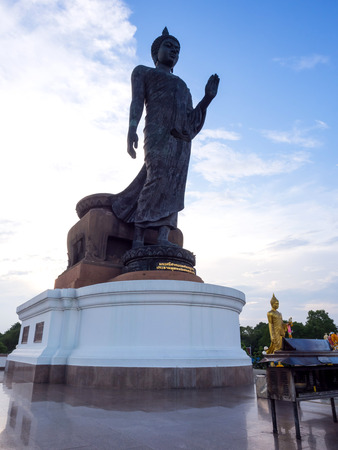province: Grand walking buddha bronze statue is the major statue in Phutthamonthon Buddhist province in Nakornpathom Thailand in twilight time Stock Photo