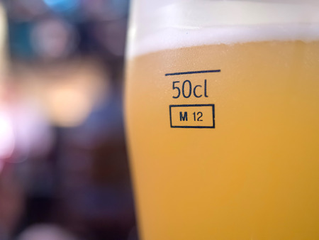 litre: Yellow beer in half litre glass Stock Photo