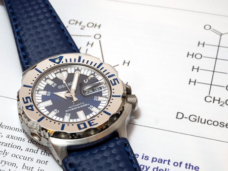 royal blue: BANGKOK - SEPTEMBER 2: Seiko diver automatic watch, Royal blue monster limited model for only Thailand, place on chemistry journal paper selective focus on watch dial, was taken on September 2, 2015, in Bangkok, Thailand.