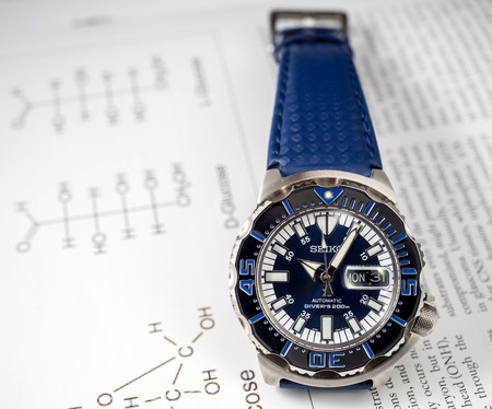 september 2: BANGKOK - SEPTEMBER 2: Seiko diver automatic watch, Royal blue monster limited model for only Thailand, place on chemistry journal paper selective focus on watch dial, was taken on September 2, 2015, in Bangkok, Thailand.