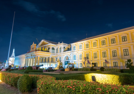 specular: European art style building of Ministry of Defense of Thailand in night light view Editorial