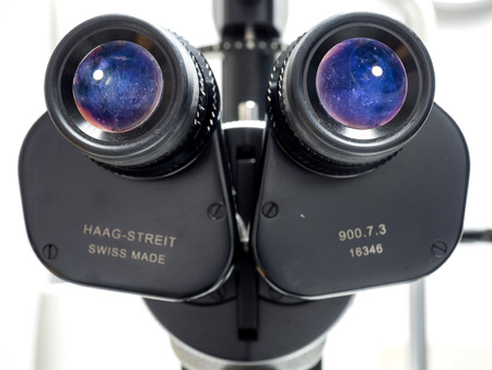 BANGKOK - JULY 29: Haag-Streit slit lamp biomicroscope is excellent eye examination instrument for ophthalmologist in hospital, selective focus on eyepieces lenses, was taken on July 29,2015, in Bangkok, Thailand 에디토리얼