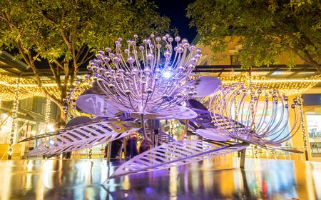 brittle: Modern art brittle fountain on pond under night sky Stock Photo