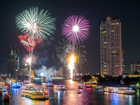 january 1: BANGKOK - JANUARY 1: New year countdown celebration fireworks along Chaophraya river, view from Taksin bridge in Bangkok, Thailand, on January 1, 2016. Editorial