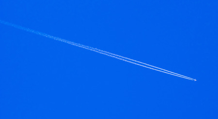 contrail: Cloud and jet contrail with blue sky background