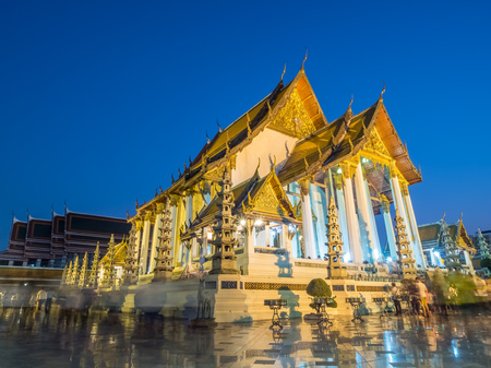 all saints day: Candle lit triple times around church of temple of Wat Suthat in Bangkok, Thailand, on Buddhist All Saints day Maka Bucha day