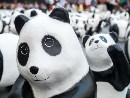 papier mache: BANGKOK - MARCH 7: 1,600 pandas world tour, papier mache sculptures of pandas with recycled paper, exhibited at Central World shopping mall in Bangkok, Thailand, was taken on March 7, 2016.