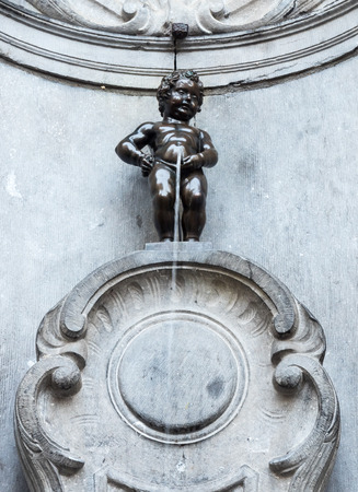 The small ,61 cm tall,  bronze statue on the corner of Rue de l'Etuve and Rue des Grands, known as