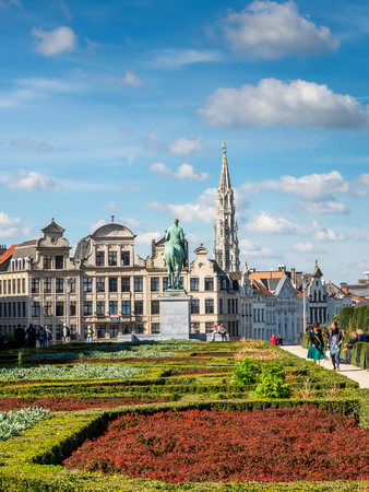 spire: Mont des Arts, with the Town Hall spire in the distance under cloudy sky in Brussels, Belgium Stock Photo