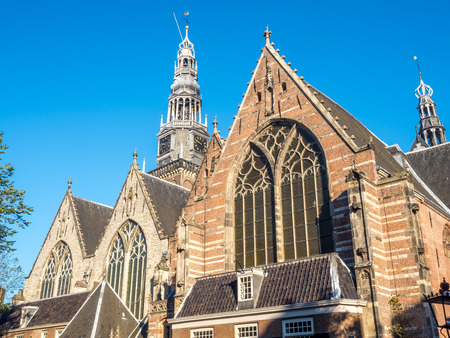 red light district: AMSTERDAM - OCTOBER 2: Old Church (Oude Kerk) in main red light district in Amsterdam, Netherlands, under blue sky, was taken on October 2, 2015. Editorial