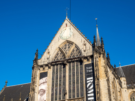 dam square: AMSTERDAM - OCTOBER 2: The Nieuwe kerk (New church) located on Dam square. The building is used for exhibition space and as museum, under clear blue sky, on October 2, 2015 in Amsterdam, Netherlands.