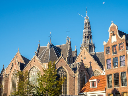 red light district: Top of the Old Church (Oude Kerk) in main red light district in Amsterdam, Netherlands, under blue sky