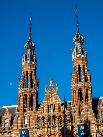 dam square: Top of building in Dam Square in Amsterdam, outstanding with European architecture art, under blue sky with moon