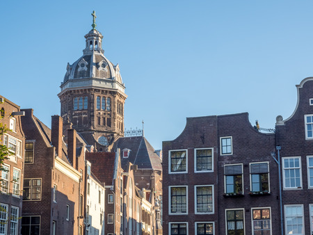 red light district: AMSTERDAM - OCTOBER 2: Saint Nichlas church fromt red light district under blue sky in Amsterdam, Netherlands, was taken on October 2, 2015. Editorial