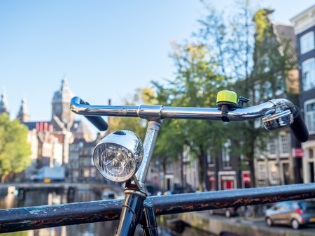 red light district: AMSTERDAM - OCTOBER 2: Saint Nichlas church front of  red light district under blue sky with bicycles in Amsterdam, Netherlands, selective focus on bicycle, was taken on October 2, 2015. Editorial